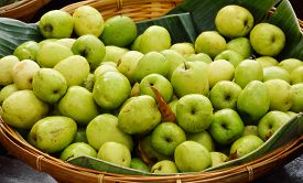 picture of indian apple  - Indian jujube in bamboo basket on the market - JPG