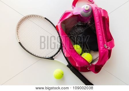 sport, fitness, healthy lifestyle and objects concept - close up of tennis racket and balls with female sports bag