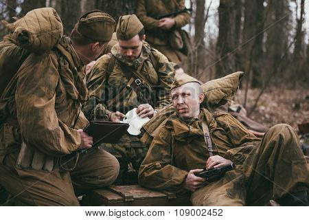 Group of unidentified re-enactors dressed as Soviet soldiers in