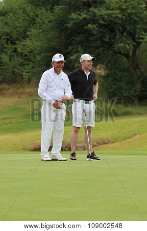 Tournament Presenter And Grand Master Gary Player Cracking A Joke With Team Mate, Singer, Songwriter