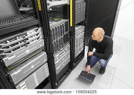 It consultant working with blade servers in datacenter