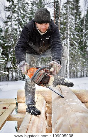 Carpenter Builds Wooden House Made Of Logs, Using Chainsaw.
