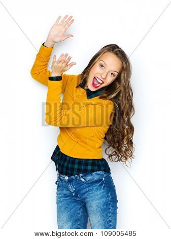 people, style and fashion concept - happy young woman or teen girl in casual clothes having fun and applauding