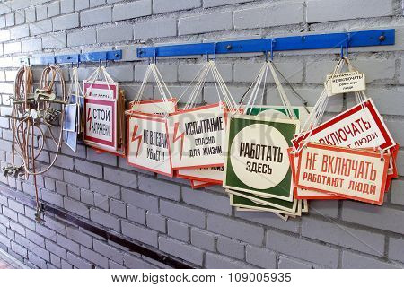 Several  Russian Industrial  Warning Sign Precaution On The Wall.
