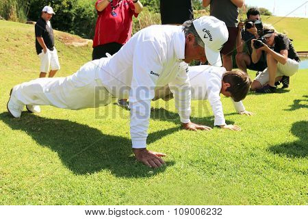 Gary Player With Grandson, Son Of Mark Player,showing Him How To Do Push-ups On November 2015 In Sou