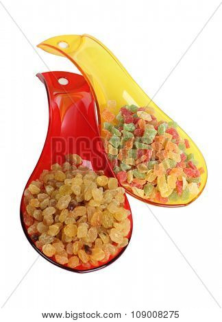 Nuts in multicolored spoons on a white background