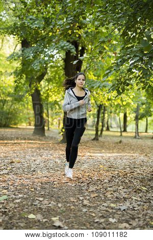 Sporty Woman Jogging In Park