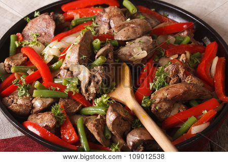 Fried Chicken Liver With Vegetables Close-up In A Pan. Horizontal