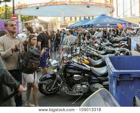 Several Bikes Among People.