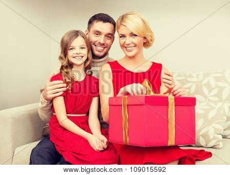 family, christmas, x-mas, happiness and people concept - happy family opening