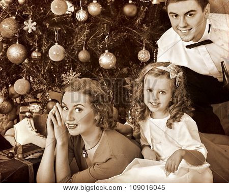 Family with children  , mother and father dressing Christmas tree. Black and white retro vintage.