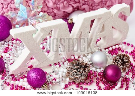 Christmas decoration with letters xmas and ornaments.