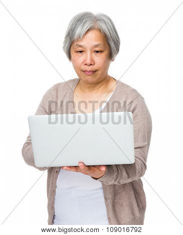 Grandmother learn to use notebook computer