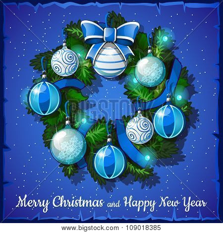 Christmas wreath with blue and white balls on a blue background