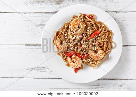 Seafood Fried Udon Noodles With Shrimps On Wooden Table. Pad Thai