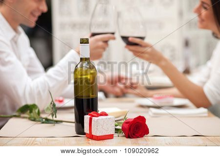 Pretty young lovers are dating in restaurant