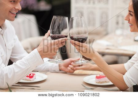 Pretty man and woman are resting in restaurant