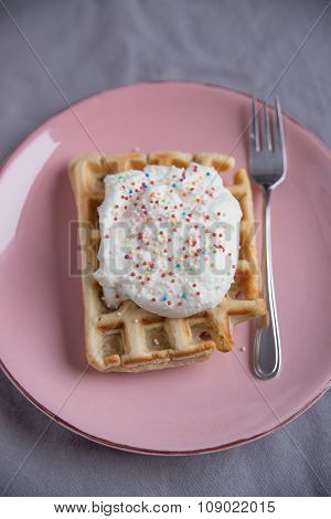 Belgian waffles with whipped cream and sprinkles