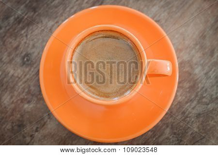 Top View Of Hot Coffee On Wooden Table