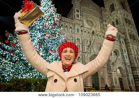 Happy Woman Rejoicing Near Christmas Tree In Florence, Italy