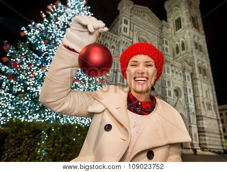 Happy Woman Showing Christmas Ball Near Duomo In Florence, Italy