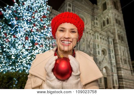 Young Woman Holding Christmas Ball Near Duomo In Florence, Italy