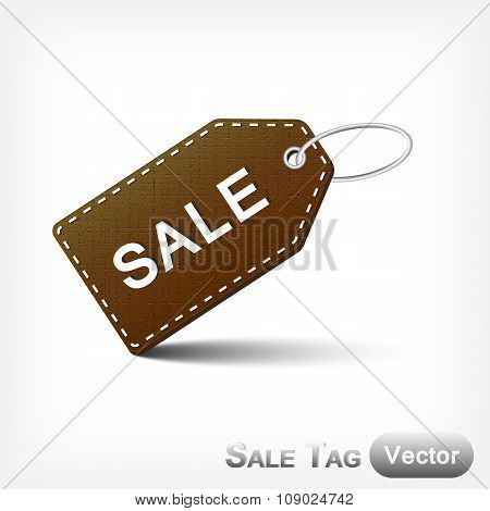 Leather Sale Tag With Metal Loop On White Background