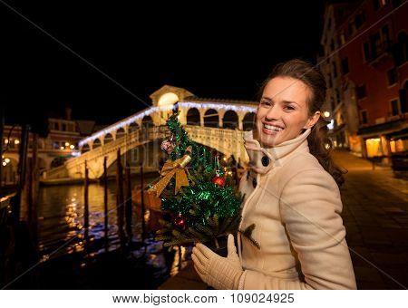 Happy Woman With Christmas Tree Near Rialto Bridge In Venice