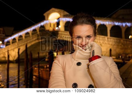 Woman Standing Near Rialto Bridge In Christmas Venice, Italy
