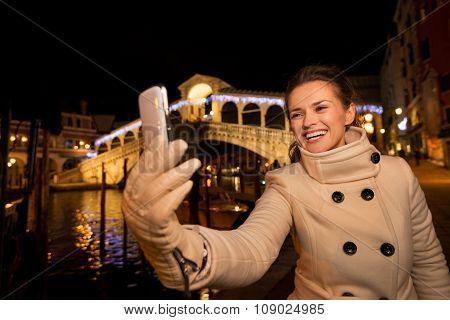 Woman Taking Selfie Near Rialto Bridge In Christmas Venice