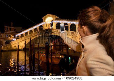 Woman Taking Photo Of Rialto Bridge In Christmas Venice, Italy