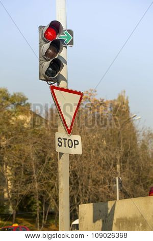 Red traffic light, Stop sign at intersection