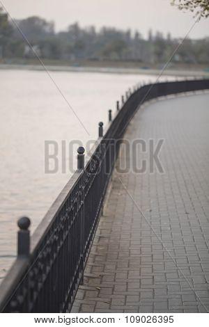 Lakeside paved walk, cast iron fence, beautiful view