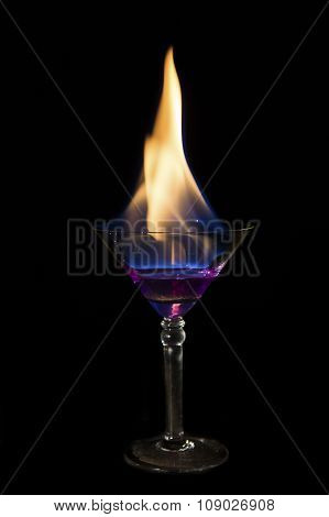 Martini Glass With Purple Drink Is On Fire And Very Hot