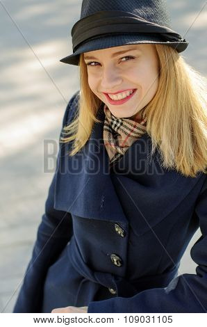 Girl In A Hat With A Golden Hair Cheerfully Laughs