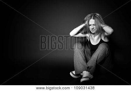 Woman In Depression And Despair Crying,  Clutching His Hands Behind His Head On Black Dark