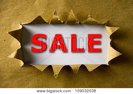 Torn Brown Paper With Sale Word