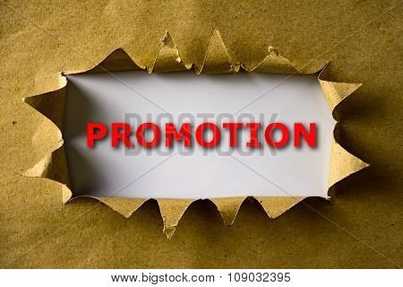 Torn Brown Paper With Promotion Word