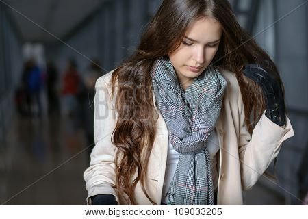 Woman With Scarf On Her Neck Is On The Move