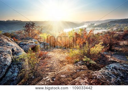 Dawn on banks of mountain river