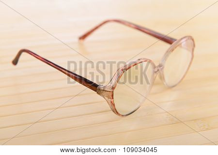 reading old glasses. close-up. on a light wooden background