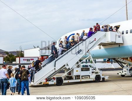 People Board The Flight Home