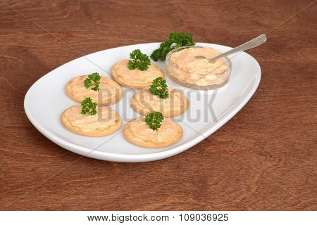 plate crackers with salmon pate and parsley