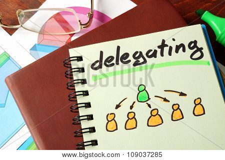 Notebook with delegating sign.