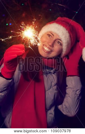 Girl In Santa Hat With Sparklers