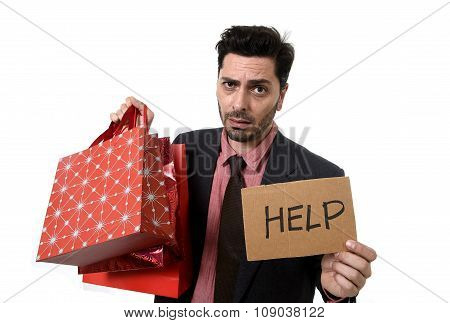 Businessman Holding Shopping Bags And Help Sign Worried And Stress Face Expression