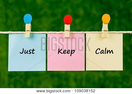 Word Quotes Of Just Keep Calm On Sticky Color Papers Hanging On Rope.