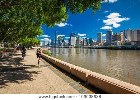 BRISBANE, AUS - NOV 18 2015: River walk in South Bank Parkland. It's inner-city man-made beach next to city center.