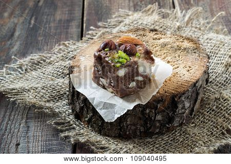 Slice Of Chocolate Fudge With Different Kinds Of Nuts