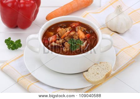 Goulash Soup With Meat, Baguette And Paprika In Bowl